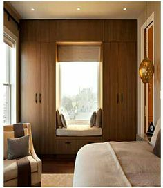 Fitted wardrobes around a windows. Ideally white with a dressing table under the window instead of a seat