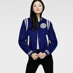 Varsity-inspired jacket with ribbed edges and leather trims. Precision-placed darts and pleats create a flattering fit.