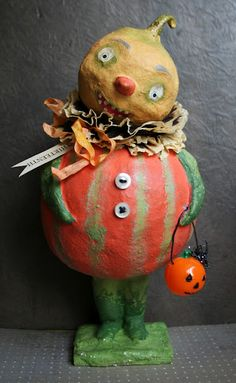 paper mache veggie boy with a tiny  pumpkin pail...I love this.