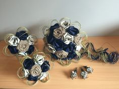 Rustic country wedding bouquet in navy, Ivory and hessian.  www.flaxation.co.nz