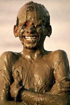 experiencehumanity:    Chocolate Boy by Amir Mukhtar Mughal | www.amirmukhtar.com on Flickr.  PAKISTAN: Boy covered in mud. Look at the glorious smile!