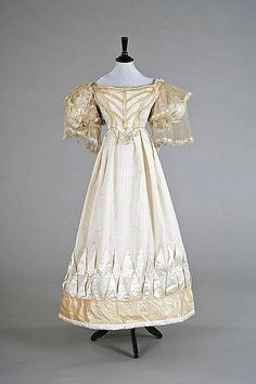 Evening dress ca. 1825, the type of dress worn at Centre Hill shortly after it was built-wasitline beginning to descend to its natural levels again,from formerly high waisted dresses of Federal era and the sleeves are beginning to balloon in fashion design of this period.
