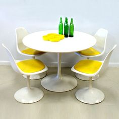 60s Tulip Table And 4 Chairs Set.  Makes me want to serve sunny side-up eggs for some reason.