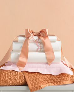 Have the bride register at a department store before the shower and have each guest bring a different linen item for the couple's collection