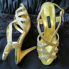 """GORGEOUS GOLD SANDAL HEELS WITH RHINESTONES These shoes are a perfect match to any Dress or Gown. The picture doesn't do the color justice.  Gold Fabric Heel with Clear Rhinestones which Crete almost a color effect.  Heel Height 3 1/2"""" Caparros Shoes Heels"""
