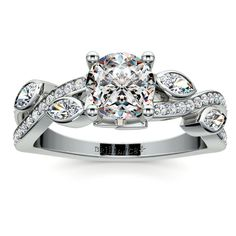 Twisted Petal Diamond Engagement Ring in Platinum Forty round cut diamonds are pave set and four marquise cut diamonds are bezel set in this elegant twisted petal diamond engagement ring setting in platinum. Approximately 2/5 carat total weight and proudly made in the USA.