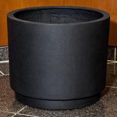 Campania International Office Park Round Planter - Elegant and minimal, the Campania International Office Park Round Planter offers subtle style. The design is crafted from fibercement, which i...
