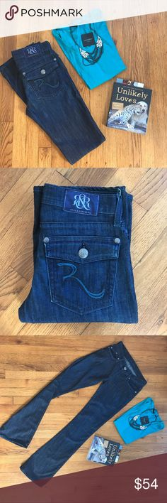 """{Rock & Republic} Teal and Black Flap Pocket [27] {Rock & Republic} These jeans are a STAPLE and gorgeous! They are NWOT! They are a classic dark wash. They have stunning blue stitching that have silver sparkle threading intertwined on the embroidering on the flap pockets. RN: 110113. Inseam: 34"""". Cotton Blend. Never Worn. Rock & Republic Jeans Boot Cut"""