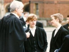 Cam LeBlanc (blond) and Michael D'Arcy (redhead) getting lectured by a priest
