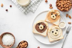 Animal face breakfast toasts with nut butter for kids on concrete background