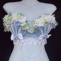 Light Blue Foral Rave Bra By Revolt Couture Perfect for any dance competition! Handmade from quality products and materials, all Revolt Couture dance wear is embellished with crystals, flowers, beads, ruffles and other fine and fun elements… Order this new item as it is or be inspired and sen...