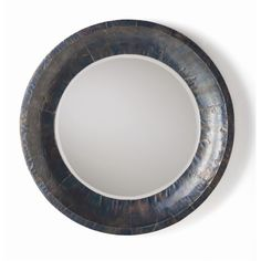 Wall Decor: Gordon Mirror (#2657). Round beveled edge accent mirror with mango wood frame that is covered with oxidized iron plating in an antique wax finish.