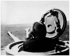 The tank commander of a PzKpfw.VI Tiger of s.Pz.Abt. 503, scans the horizon for enemy forces.