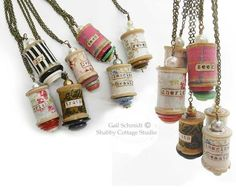 Pendants made from decorated thread spools.