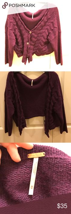 Gorgeous deep purple slouchy free people sweater This sweater is such a gorgeous deep purple color.  Looks amazing thrown over any t shirt or even a more dressed up shirt.  It hangs nicely on the body and is super comfy too.  Worn once.  Has fancy black buttons with black gemstones (none missing).  LOVE Free People Sweaters
