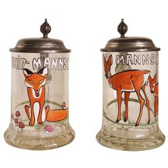 Rare Pair of German Jugendstil Hunting Steins with Enamelled Designs after Ludwig Hohwein | From a unique collection of antique and modern barware at https://www.1stdibs.com/furniture/dining-entertaining/barware/