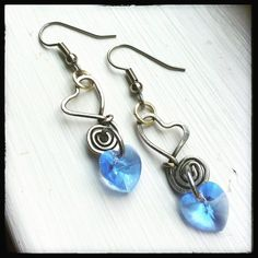 Sweet Hearts. Eyecatching dangle earrings created from cold forged, wire wrapped silver filled jewelry wire. Each heart is formed and hammered by hand and beautifully accented with a free hanging sapp