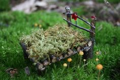 Fairy bed (shown), bench, table and chairs, made from twigs and decorated with beads. Also a tiny set of WINDCHIMES for the fairy house