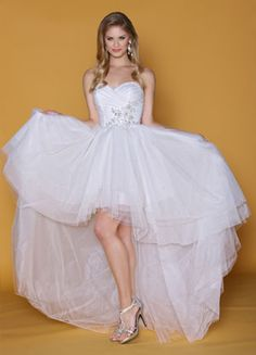 Super cute hi-low informal wedding gown.  A perfect choice to showcase your cowgirl boots! Schedule your appointment to try it on at http://rainbowsendweddings.com/appointment-request/ @rainbowsendwed #bridal #rainbowsendweddings