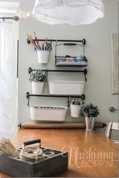 Great ideas to use curtain rods and hanging baskets for sewing room storage and a rod for paper for pattern making! LOVE!!!