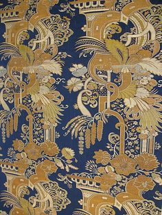"""A small number of Chinese textiles were based on European """"bizarre"""" silk designs. This example combines a sophisticated mélange of lush flora and fantastic architectural features—elements that periodically appeared in European silks from about 1695 to 1720. The gilt-paper-wrapped thread woven into the fabric is uniquely Chinese, but the cloth's narrow loom width is the same as that of many eighteenth-century European dress silks."""