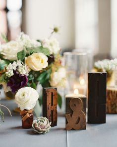 Rich wooden letter blocks were the bride's favorite table decor item. Click to see more images of this South Carolina real wedding!