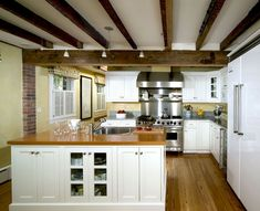 Excellent Faux Wood Ceiling Beams And Planks : Exposed Dark Wood Beams And Drywall Wood Plank Flooring Shaker Cabinets And Exposed Ceilings With Lower Support Beam Exposed Ceilings, Exposed Beams, Wood Ceilings, Ceiling Beams, White Ceiling, Modern Ceiling, White Walls, Modern Farmhouse Kitchens, Farmhouse Kitchen Decor