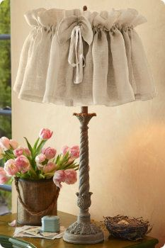 "Linen Lamp Shade. I re-used some ""near"" linen valences to create fluffy lamp shades like this. I used pink striped cording for the bow and it looks great."