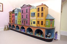 Fabulous Child Organizer / Storage...  Imagine each section as a different doll house...  A Street of doll houses!
