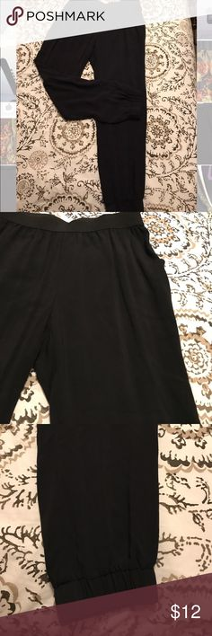 Cute black pants with a tapered cuff. Cute black pants with a tapered cuff. These fit like a jr.'s large and can be dressed up or down. They look great with heels, wedges or a pair of converse. I love how versatile they are! Pants
