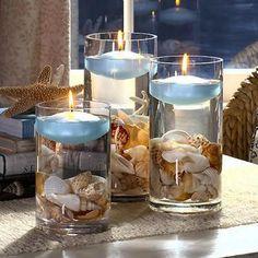 Show me your beach theme centerpieces please! - Weddingbee [ Show me your beach theme centerpieces please! Beach Theme Centerpieces, Nautical Centerpiece, Beach Wedding Decorations, Table Decorations, Beach Centerpiece Wedding, Beach Themed Weddings, Seashell Centerpieces, Fish Centerpiece, Seashell Candles