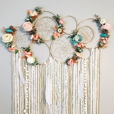 Eeepp!! I am so loving the color combo on the florals in this piece! Theres a matching mobile in my shop as well. There are 7 bare wood hoops connected, 2 of which have hoops within them, and 4 hoops have sparkle twine webs, 2 of which are hand woven authentic webs and 2 are
