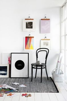 black and white room with colorful artwork