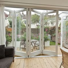 Folding Doors. So pretty! Like this look? Need help with a renovation? www.CooperHomesInc.com can do this for you if you are in the Metro-Atlanta area!