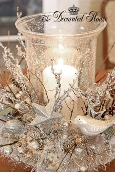 spray snow, sprigs, birds and candle light, shimmering country Christmas centerpiece