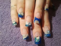 blue Hello Kitty glitter nails  call Kristal at 916-670-0010 for an appointment in Sacramento