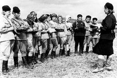 Night Witches from the 46th Taman Guards Night Bomber Avation Regiment preparing for an upcoming raid during World War II, 1944. From Sovfoto/UIG via Getty Images.