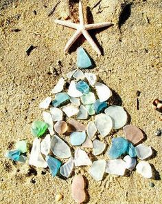 Seaglass Christmas Tree on the Beach -  Celebrate Christmas by the sea and on the beach, even if only in your dreams! Each piece of glass for this seaglass Christmas tree photograph was found by the artist, Rose Hibbetts, along the Outer Banks of North Carolina. Rose lives in Naples, FL, where she'll be enjoying a warm Holiday and Christmas season on the beach. I wish I was there!   Seaglass Christmas Tree on the Beach
