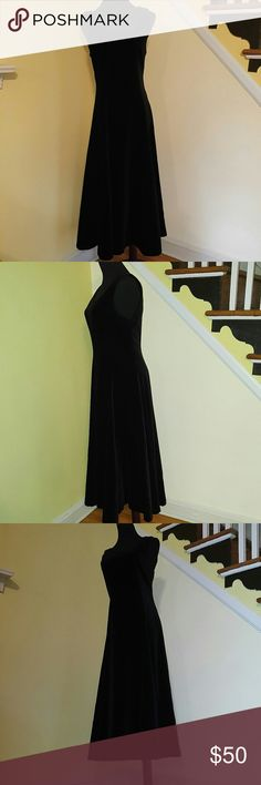 """Vintage Black Velvet Laura Ashly Maxi Dress 6 Vintage Black Velvet Laura Ashly Maxi Dress 6 Made in Great Britain Jumper Maxi Dress with Flared Bottom Fully Lined Long Back Zipper Very Black Very Plush Fabric Has Weight Wonderful Condition! Bust: 34"""" Length: 49"""" Waist: 30"""" Hips: Free Left Side Of Bottom has 20 """" Sexy Split Laura Ashley Dresses Maxi"""