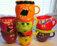 Funny Face (like Kool Aid) cups - you sent away for these with a proof of purchase.  I had the orange one!