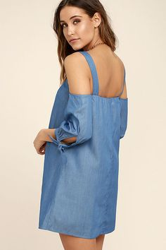 Lulus Exclusive! Head home after an exciting day spent in the Be Home Soon Blue Chambray Off-the-Shoulder Dress! Woven chambray shapes wide straps that support a darted, shift bodice with an elasticized, off-the-shoulder neckline (with no-slip strips), and mini skirt. Half sleeves have tying cuffs.