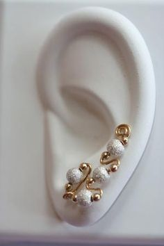 Wireworks creations earrings. These earrings give the impression of multiple piercings even though there is only one $38.00