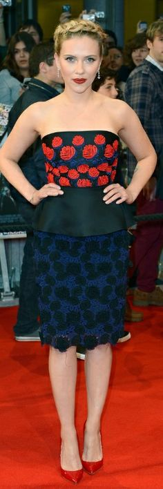 Who made Scarlett Johansson's jewelry, polka dot dress, and red pumps that she wore in London on April 19, 2012? Dress – Prada  Jewelry – Bulgari  Shoes – Christian Louboutin