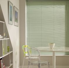 Our Putting Green Venetian blind has bags of style and is a great way to bring the outside in. We've used it here in our stylish dining room.
