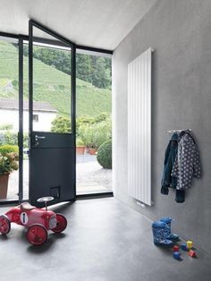 Runtal Flat Panel Wall Radiator, Remodelista - European-style radiators now available in the US Wall Radiators, Steel Frame Doors, Barn Renovation, Interior Architecture, Interior Design, Polished Concrete, Room Doors, Construction, Concrete Floors