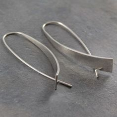 Elliptical Silver Drop Earrings - These unique sterling Elliptical Silver Drop Earrings are show stopper material! These statement accessories are worthy of any collection and can be used everyday. #Otisjaxon #Jewellery #Curl #Earrings