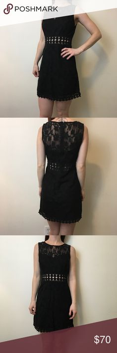 FREE PEOPLE Black Cut Out Crochet Knit Dress Cute Free People BLACK dress with a cut out center mid drift and is mini style. Lined underneath and has a side zipper closure. In excellent condition and is a size 4. Free People Dresses Mini