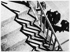 [Stairs, Railing, Shadows and Four Men] / Andre Kertesz / 1951 / gelatin silver print