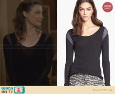 Britta's black long sleeve top with grey shoulders on Community. Outfit Details: http://wornontv.net/29049 #Community #fashion