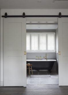 Explore this once-traditional country Buckinghamshire home where Scandi goes plush Create a monochrome bathroom the Scandi Cool way by highlighting key features and balancing with bronze taps and shower attachments. Monochrome Bathroom, Interior, Sliding Doors Interior, Doors Interior, Scandinavian Bathroom, Trending Decor, Bathrooms Remodel, Bathroom Design, Bathroom Decor